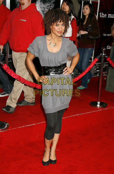 """TRACIE THOMS.""""The Number 23"""" Los Angeles Premiere held at the Orpheum Theater, Los Angeles, California, USA..February 13th, 2007.full length grey gray dress leggings hands on hips black.CAP/ADM/RE.©Russ Elliot/AdMedia/Capital Pictures *** Local Caption *** .."""