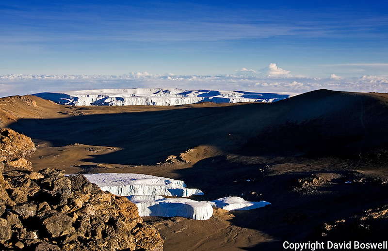 A view of the crater on Kibo, the highest peak on Mount Kilimanjaro in Northern Tanzania.  The Furtwangler Glacier is shown in the foreground and the Northern Icefield is in the background.
