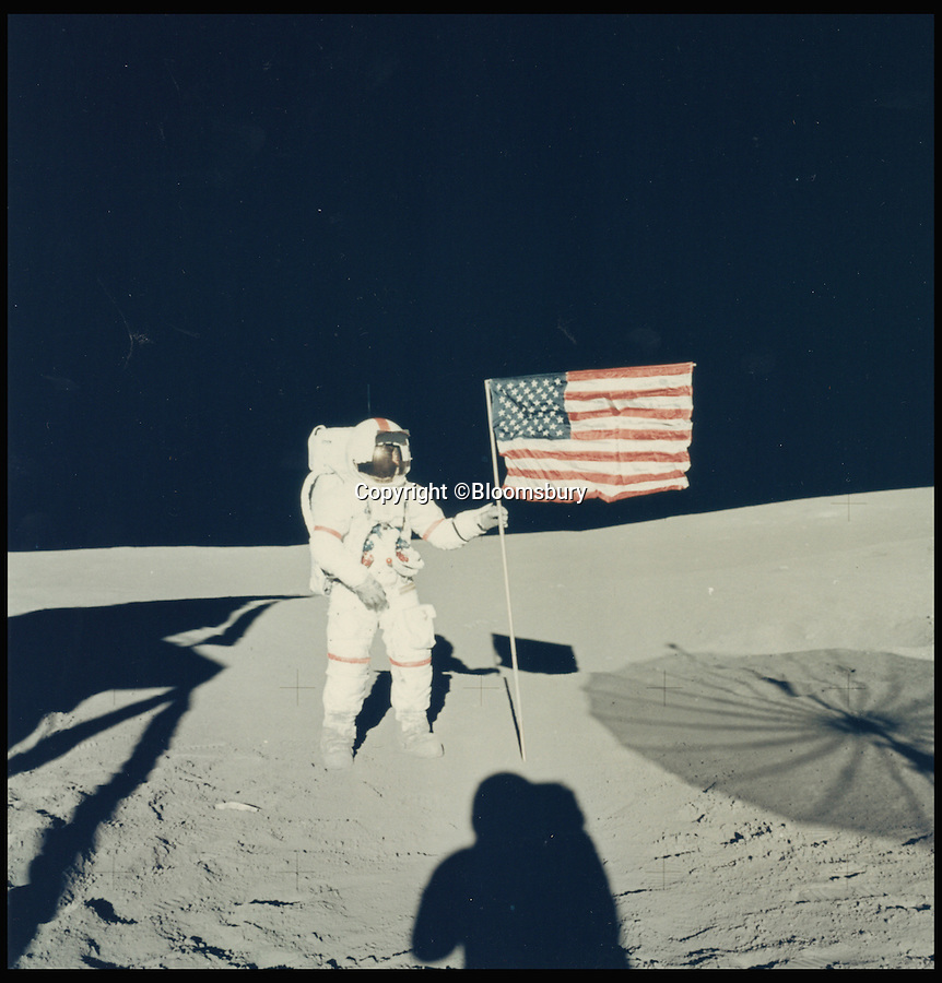 BNPS.co.uk (01202 558833)<br /> Pic: Bloomsbury/BNPS<br /> <br /> ***Please Use Full Byline***<br /> <br /> Lot 434: Photo by Edgar Mitchell of Alan Shepard and the American flag,  Apollo 14, February 1971. Est: £800.<br /> <br /> An out-of-this-world collection of vintage NASA photographs including the first ever snap from space and the first space selfie has emerged for sale for a whopping £500,000.<br /> <br /> The archive of more than 600 photographs, many of which are unseen, covers NASA's groundbreaking space programme from its beginnings in the late 1950s through to the triumphant moon landing of 1969 and beyond.<br /> <br /> The incredible collection of original photos has been painstakingly pieced together over several decades by a private collector.<br /> <br /> It is the first time such a comprehensive collection of vintage NASA photographs has ever been sold at auction.