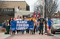 NWA Democrat-Gazette/BEN GOFF @NWABENGOFF<br /> Participants march from the Shiloh Square to South Thompson Street Saturday, March 24, 2018, during the March for our Lives event in downtown Springdale. The local march was organized by students from Springdale Har-Ber High in solidarity with marches across the country today to call for an end to gun violence.