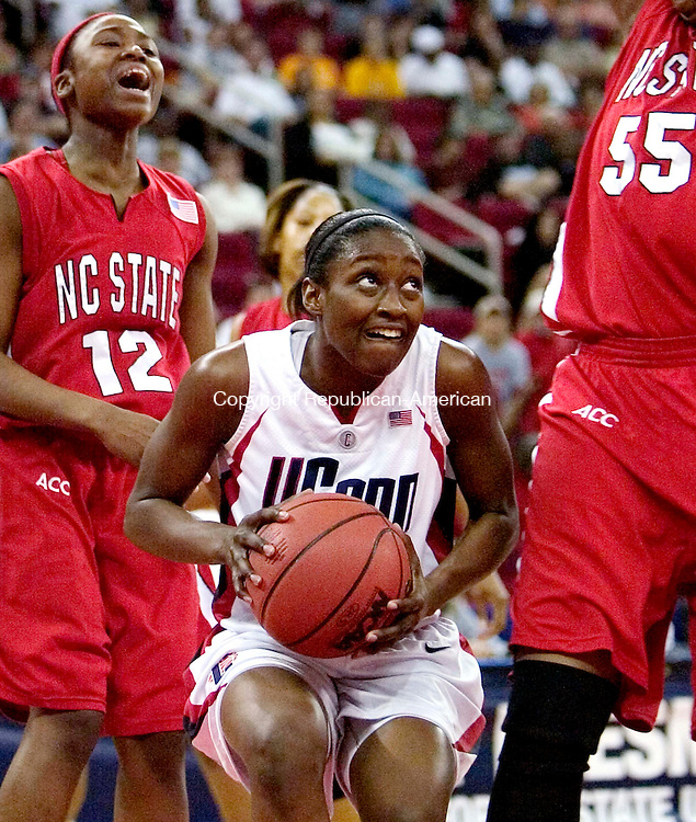 FRESNO, CA. 24 March 2007-032407SV02--#32 Kalana Greene of UConn triesto ge up for a s hot as #55 Gillian Goring of NC State defends during the sweet sixteen round of the NCAA tournament at the Save Mart Center in Fresno, CA. Saturday. at left #12 Marquetta Dickens of NC State.<br /> Steven Valenti Republican-American