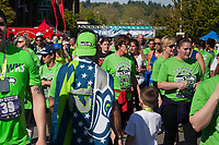 Man wearing Seahawks flag, Seahawks 12K Run 2016, The Landing, Renton, Washington, USA.