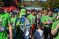 Man wearing Seahawks flag, Seahawks 12K Run 2016, The Landing, Renton, Washington, USA.