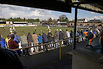 Southport fans in the covered enclosure watching their team playing in their change kit of all-white taking on Harrogate Town at Wetherby Road, Harrogate. The Conference North match was won 3-2 by Southport, a result which kept the Sandgrounders on course for top spot in the division while Harrogate Town remained bottom.