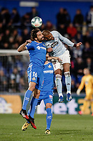 7th March 2020; Coliseum Alfonso Perez, Madrid, Spain; La Liga Football, Club Getafe Club de Futbol versus Celta Vigo; Rafinha (Celta de Vigo) wins the header from Xabi Etxeita (Getafe CF)