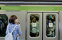 Tokyo, Japan - A packed train stops at Shinjuku Station. Morning commuters typically spend over one hour on the train going to work. Trains are usually so packed that train platform staff have to push commuters to fit in the train so that the doors can close shut. (Photo by Yumeto Yamazaki/AFLO)