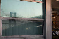 Williamsburg, Brooklyn - 19 October 2008 - Reflection of the Williamsburg Bridge in a window of the Domino Sugar Factory in Williamsburg, Brooklyn. Refinery, LLC, the developer who plans to convert the landmarked refinery into residential units, invited everyone over for free refreshments and a chance to take in the East River views.