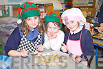 BAKING FUN: Charlotte Browne, Gianna Fitzgibbon and Edel Browne of Flemby NS, Ballymacelligott enjoying their Christmas Cookie Day on Friday...