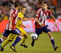 Chivas USA midfielder Blair Gavin (18) moves past Columbus Crew midfielder Robbie Rogers (18). CD Chivas USA defeated the Columbus Crew 3-1 at Home Depot Center stadium in Carson, California on Saturday July 31, 2010.