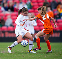 Tara Schwitter (24) of Miami tries to stop Danielle Hubka (34) of Maryland during the game at Ludwig Field in College Park, MD.  Maryland defeated Miami, 2-1, in overtime.