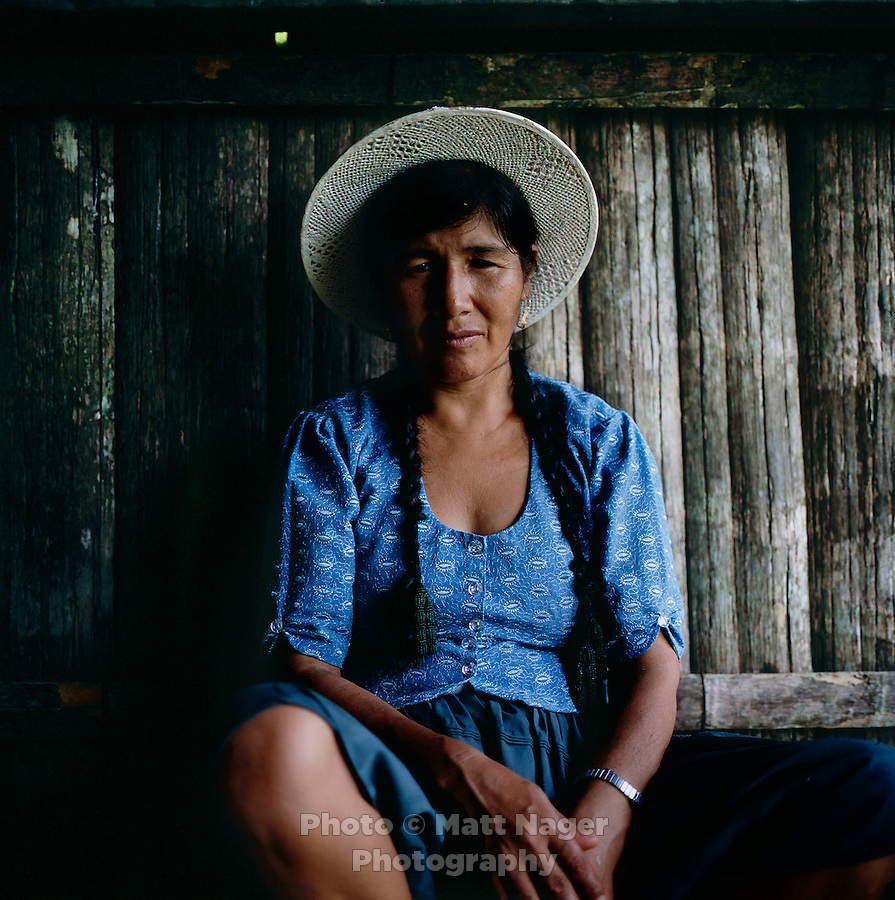 Apolonia Sanchez sits in her home in the Chaparé jungles near here coca field in Bolivia. Sanchez, came to the Chaparé in search of more money through the selling of coca leaves.