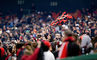 A D.C. United fan waves a flag in the stands during the game at RFK Stadium in Washington, DC.  Sporting KC defeated D.C. United, 1-0.