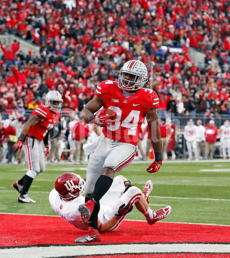 Ohio State Buckeyes running back Carlos Hyde (34) scores on a rushing touchdown against Indiana Hoosiers during the second quarter of their College football game at Ohio Stadium in Columbus, Ohio on November 23, 2013.  (Dispatch photo by Kyle Robertson)