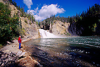 Sports Fisherman fishing at Smith River Falls, Northern BC, British Columbia, Canada - along Alaska Highway