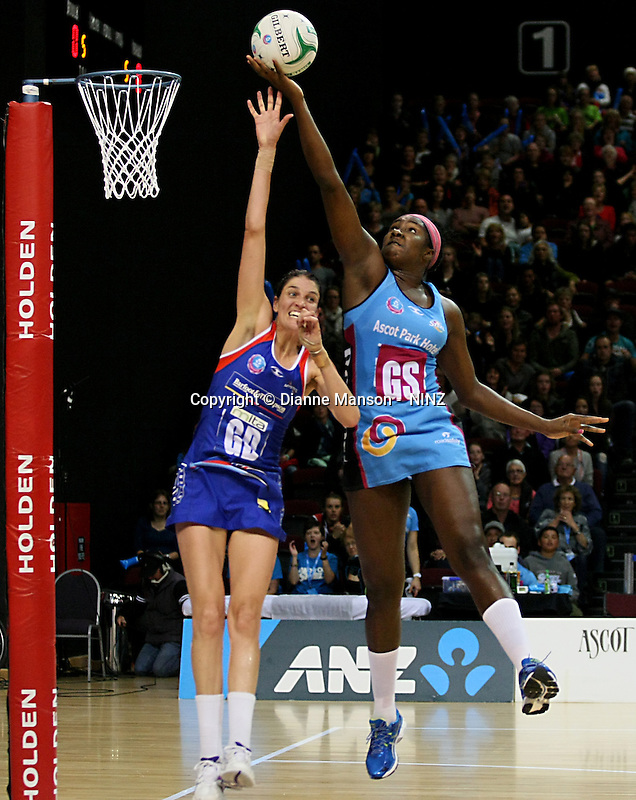 Mystics Anna Harrison, left, and Jhaniele Fowler-Reid compete for the ball in the ANZ championship netball match, Steel v Mystics, ILT Stadium Southland, Invercargill, New Zealand, Sunday, April 6, 2014. Photo: Dianne Manson