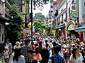 July 24, 2011 - Yokohama, Japan - Many tourists visit Chinatown on a daily basis to enjoy an authentic Chinese cultural experience. Yokohama Chinatown is a largest Chinatown in Asia with a history that dates back to approximately 150 years. Until today, it still remains as a popular tourist destination for locals and travelers abroad. (Photo by Yumeto Yamazaki/AFLO)