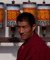 Monk at prayer wheels in a Buddhist  Monastery, Sikkim, India