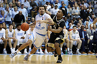 CHAPEL HILL, NC - MARCH 03: Cole Anthony #2 of the University of North Carolina drives past Brandon Childress #0 of Wake Forest University during a game between Wake Forest and North Carolina at Dean E. Smith Center on March 03, 2020 in Chapel Hill, North Carolina.