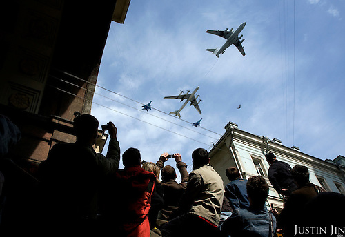 Jet fighters fly over Russians celebrate Victory Day in Moscow.