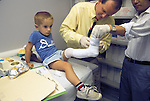 DOCTORS NOT MODEL RELEASED; FOR EDITORIAL USE ONLY... A new cast being put on a 2 year old boy's leg in orthopedics clinic