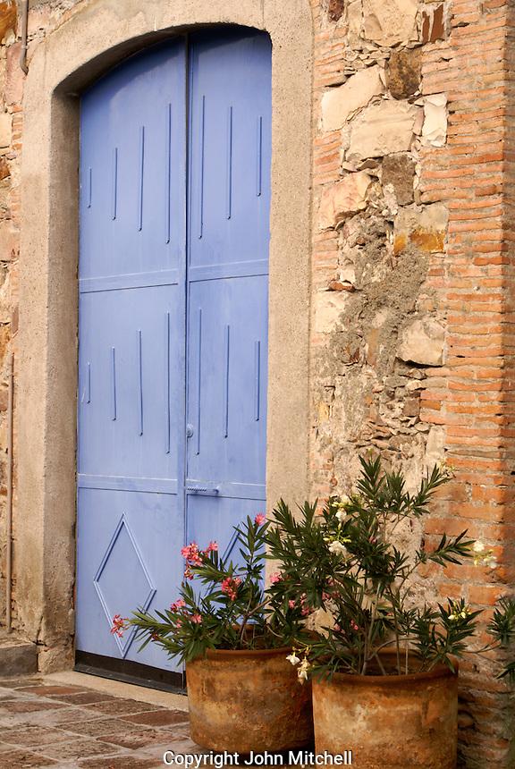 Blue door in Fabrica La Aurora Art and Design Center, San Miguel de Allende, Mexico. San Miguel de Allende is a UNESCO World Heritage Site....