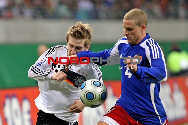 L&permil;nderspiel<br /> WM 2010 Qualifikatonsspiel Qualificationmatch Leipzig 28.03.2009 Zentralstadion Gruppe 4 Group Four <br /> <br /> Deutschland ( GER ) - Liechtenstein ( LIS )<br /> <br /> Zweikampf Marko Marin (#8 M&cedil;nchen Gladbach Deutsche Nationalmannschaft) und Yves Oehri (#4 Liechtenstein Nationalmannschaft).<br /> <br /> Foto &copy; nph (  nordphoto  )<br />  *** Local Caption ***