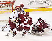 Pat Mullane (BC - 11), Michael Marcou (UMass - 22), Kevin Czepiel (UMass - 3), Paul Dainton (UMass - 31) - The Boston College Eagles defeated the University of Massachusetts-Amherst Minutemen 5-2 on Saturday, March 13, 2010, at Conte Forum in Chestnut Hill, Massachusetts, to sweep their Hockey East Quarterfinals matchup.