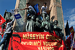 "Young protesters take a police shield emblazoned with the word Katil--""killer"" in English--on top of the Monument to the Republic in Taksim Square, Istanbul, Turkey, June 1, 2013. The monument depicts Mustafa Kemal Ataturk and was inaugurated in 1928, five years after the republic was founded. What started as a peaceful sit-in to save a small park near Taksim Square from being turned into a shopping mall has turned into large-scale anti-government demonstrations in cities across Turkey."