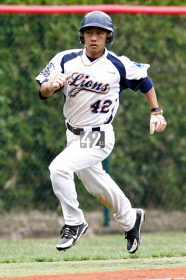 16 July 2011: Daisuke Dice Ikenaga runs during the 2011 Challenge de France match won 5-4 by the Savigny Lions over the Senart Templiers, at Stade Pierre Rolland, in Rouen, France.