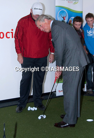 """PRINCE CHARLES.The Prince of Wales, Prince Charles visits the first Ryder Cup to be held in Wales at Celtic Manor.The Prince met the captains of both the US and European teams Colin Montgomerie and Corey Pavin_Newport, Wales _29/09/2010.Picture shows: Prince Charles trying his hand at sinking a putt..Mandatory Credit Photo: ©DIASIMAGES..**ALL FEES PAYABLE TO: """"NEWSPIX INTERNATIONAL""""**..IMMEDIATE CONFIRMATION OF USAGE REQUIRED:.Newspix International, 31 Chinnery Hill, Bishop's Stortford, ENGLAND CM23 3PS.Tel:+441279 324672  ; Fax: +441279656877.Mobile:  07775681153.e-mail: info@newspixinternational.co.uk"""