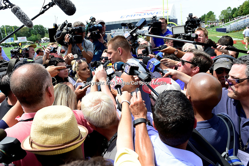 Thursday, July 28, 2016: New England Patriots tight end Rob Gronkowski (87) is swarmed by media at the New England Patriots training camp held on the practice fields at Gillette Stadium in Foxborough Massachusetts. Eric Canha/CSM