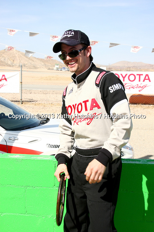 LOS ANGELES - MAR 23:  Jackson Rathbone playing with a old racing wheel at the 37th Annual Toyota Pro/Celebrity Race training at the Willow Springs International Speedway on March 23, 2013 in Rosamond, CA          EXCLUSIVE PHOTO
