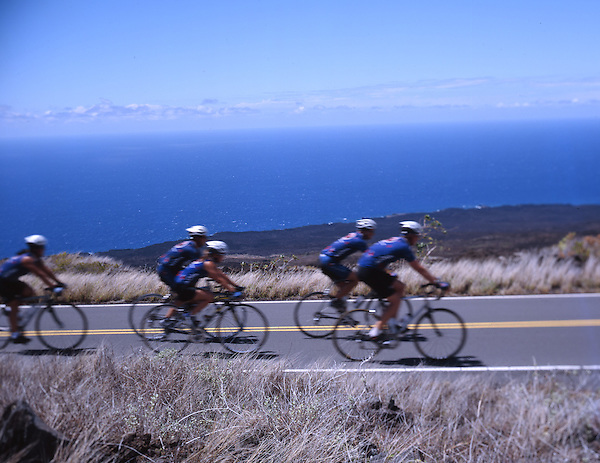Cyclists pass through lava fields with views of the Pacific Ocean on the leeward side of Maui. Photo by Kevin J. Miyazaki/Redux