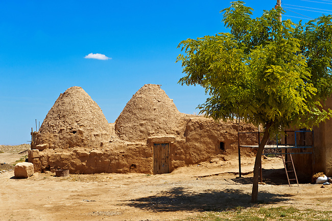 """Pictures of the beehive adobe buildings of Harran, south west Anatolia, Turkey.  Harran was a major ancient city in Upper Mesopotamia whose site is near the modern village of Altınbaşak, Turkey, 24 miles (44 kilometers) southeast of Şanlıurfa. The location is in a district of Şanlıurfa Province that is also named """"Harran"""". Harran is famous for its traditional 'beehive' adobe houses, constructed entirely without wood. The design of these makes them cool inside. 42"""