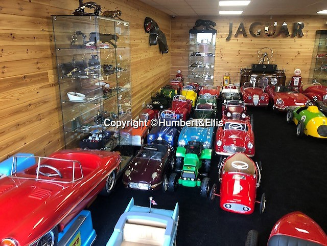 BNPS.co.uk (01202 558833)<br /> Pic: Humbert&Ellis/BNPS<br /> <br /> £200,000 of pedal power...<br /> <br /> A remarkable single owner collection of over 85 vintage toy cars has emerged for sale for £200,000.<br /> <br /> The fleet of rare pedal cars which were acquired over half a century form what is thought to be the biggest private collection of its kind in the world.<br /> <br /> It includes child car models of Rolls Royces, Bugattis and Bentleys, as well as a quirky amphibian car. <br /> <br /> The collection has been consigned for sale with Humbert & Ellis Auctioneers by a retired businessman in his 80s.<br /> <br /> He travelled all over the world to get his hands on the cars, and built a barn next to his Devon home to display them in.