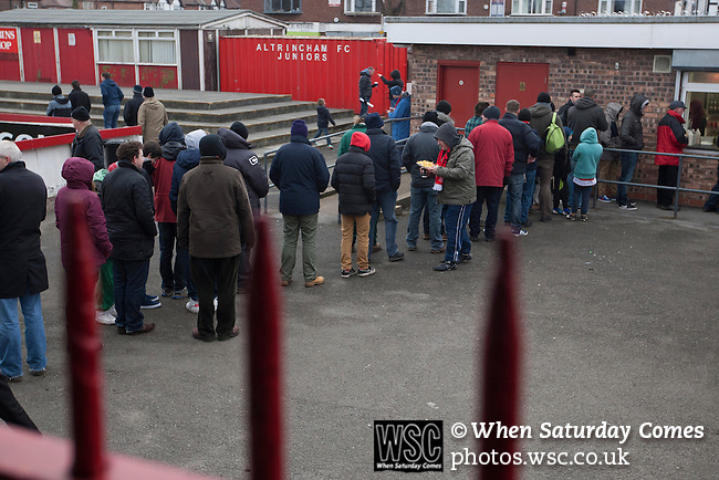 Altrincham 2 Worcester City 0, 23/03/2013. Moss Lane, Blue Square Bet North. Spectators queueing for refreshments during half-time at the the Blue Square Bet North fixture between Altrincham (in red) and Worcester City at Moss Lane, Altrincham. The home team won the match 2-0 watched by 777 spectators on a day when most non-League football in England was cancelled due to adverse weather. Altrincham were historically one of the major English non-League teams but have never been promoted to the Football League. Photo by Colin McPherson.