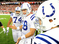 Sept. 27, 2009; Glendale, AZ, USA; Indianapolis Colts quarterback (18) Peyton Manning huddles with teammates prior to the game against the Arizona Cardinals at University of Phoenix Stadium. Indianapolis defeated Arizona 31-10. Mandatory Credit: Mark J. Rebilas-