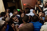 Haitian people fight over food in a food distribution center run by a private Christian organization in Port-au-Prince, Haiti, 8 July 2008. The overall situation on Haiti gets worse every year and the extreme, hardly imaginable poverty hits more and more people. The Haitian economics is paralysed, there is no infrastructure, no food supplies, the population suffer from hunger, social and living conditions in Haitian slums (e.g. Cité Soleil) are a human tragedy. The rage grows and the tension continues with undiminished strength.