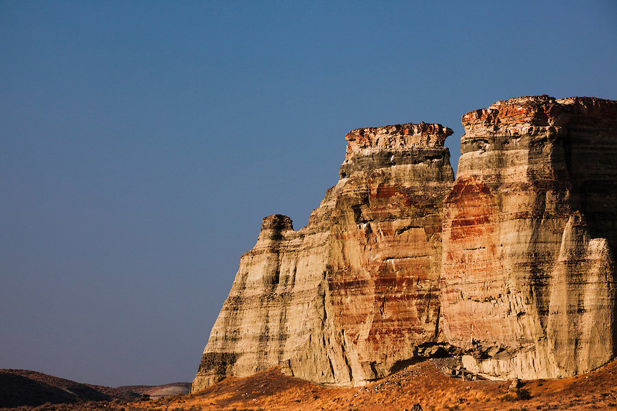 Sunrise lights the front of one of the sandstone formations at the Pillars of Rome in Southeast Oregon.