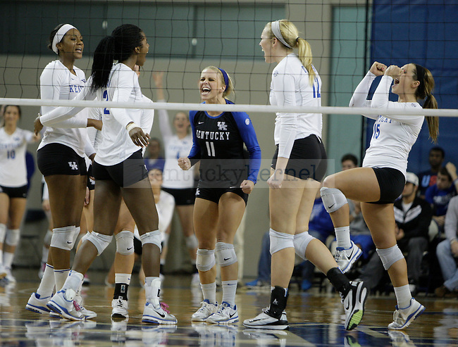 The team celebrates after a match win during the UK women's volleyball game v. Ohio University during the second round of the NCAA tournament in Memorial Coliseum in Lexington, Ky., on Saturday, December 1, 2012. Photo by Genevieve Adams | Staff