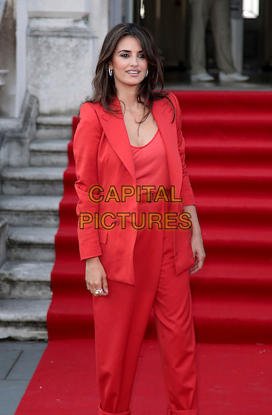 "PENELOPE CRUZ .Attending the UK Film Premiere of ""Broken Embraces"" (Los Abrazos Rotos) at Somerset House, London, England, UK, July 30th 2009..half 3/4 length blazer red jacket shoulder pads trousers catsuit pantsuit jumpsuit  high waisted belt .CAP/CAS.©Bob Cass/Capital Pictures"