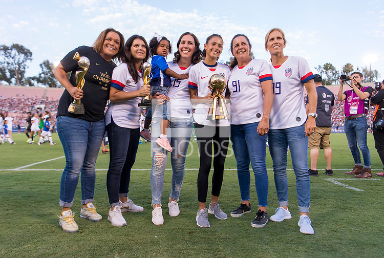 PASADENA, CA - AUGUST 4: Saskia Webber, Mia Hamm, Lauren Cheney, Joy Fawcett and Kristine Lilly stand with the World Cup trophies. during a game between Ireland and USWNT at Rose Bowl on August 3, 2019 in Pasadena, California.