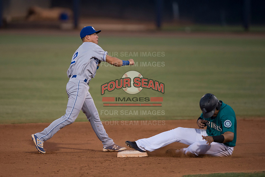 AZL Mariners second baseman Kember Nacero (2) attempts to turn a double play ahead of Danny Contreras (23) during an Arizona League game against the AZL Royals at Peoria Sports Complex on July 25, 2018 in Peoria, Arizona. The AZL Mariners defeated the AZL Royals 5-3. (Zachary Lucy/Four Seam Images)