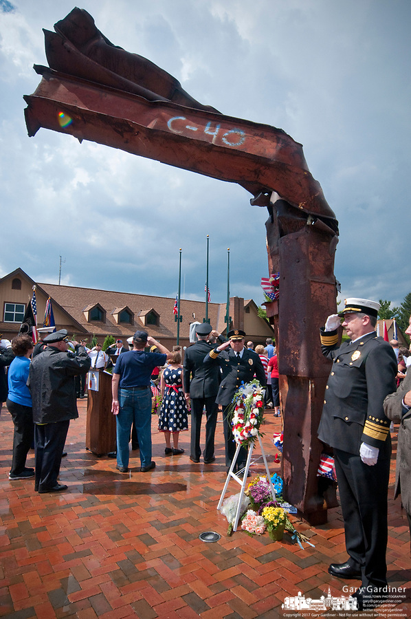 Ceremonies at First Responders Park in Westerville, OH, marking the 10th anniversary of the attack on the World Trade Center. Salutes during the playing of Taps at the conclusion of the ceremony beneath a piece of steel from the World Trade Center.