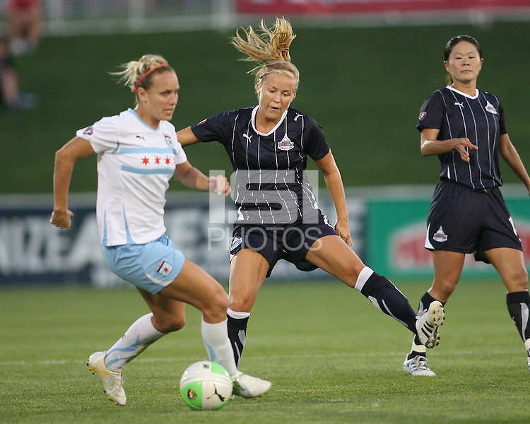 Lene Mykjaland #7 of the Washington Freedom moves in on Natalie Spilger #13 of the Chicago Red Stars during a WPS match at Maryland Soccerplex on August 19 2010, in Boyds, Maryland. Freedom won 2-0.