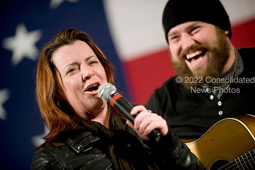 Kandahar, Afghanistan - December 17, 2008 -- Comedian Kathleen Madigan, left, and musician Zack Brown, right, entertain troops stationed at Kandahar, Afghanistan during the  2008 USO Holiday Tour  on Wednesday, December 17, 2008. Tour host United States Navy Admiral Mike Mullen, chairman of the Joint Chiefs of Staff, along with his wife Deborah, welcomed comedians John Bowman and Lewis Black; actress Tichina Arnold; American Idol contestant and country musician Kellie Pickler and Grammy award winning musician Kid Rock on the tour bringing music and entertainment to service members and their families stationed overseas..Credit: Chad J. McNeeley - DoD via CNP