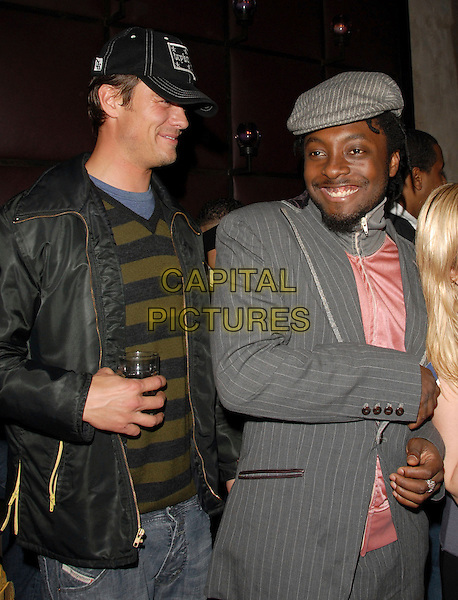 JOSH DUHAMEL & WILL.I.AM.Fergie's Birthday Party at Citizen Smith Nightclub in Hollywood, California, USA. .March 28th, 2006.Ref: DVS.half length black eyed peas baseball cap hat black jacket grey gray suit pinstripe.www.capitalpictures.com.sales@capitalpictures.com.Supplied By Capital PIctures