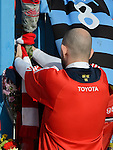 A fan ties his scarf to the gates of Thomond Park, in tribute to Munster and Ireland's Anthony Foley following his passing in France on Sunday. Photograph by John Kelly.
