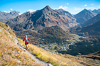 Trail running near Maloja, in the Engadin, during the fall colors. Switzerland