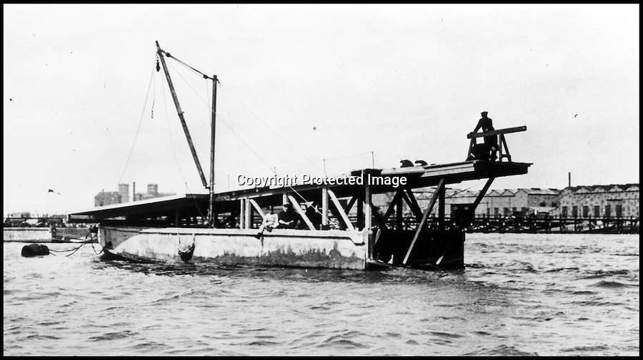 BNPS.co.uk (01202 558833)<br /> Pic: FleetAirArmMuseum/BNPS<br /> <br /> ***Must Use Full Byline***<br /> <br /> Take off ramp being constructed.<br /> <br /> Worlds first Aircraft Carrier restored.<br /> <br /> An amazing tale of bravery and ingenuity from the First World War has been revealed as the worlds first aircraft carrier has been restored at the Fleet air arm museum in Somerset.<br /> <br /> Measuring just 58ft long, the precarious craft was invented to counter the threat of Zepplin raids over London and enabled a plucky pilot to launch his Sopwith Camel at the enemy from the North sea before the feared airships could reach Britain.<br /> <br /> The tiny carriers were towed out from port behind a battleship with the aircraft strapped to the top of a wooden ramp. The crew and pilot would have to endure the conditions before an enemy was spotted and the ship then towed them into wind as fast as they could.<br /> <br /> The pilot had just 58ft of 'runway' to get the plane airborne or it would plummet into the sea with disastrous consequences.<br /> <br /> A team of seamen had to hold the plane back while the pilot got the engine up to speed then release the chocks at the right moment.<br /> <br /> Incredibly even if the plane made it into the air, the only way the pilot could land again was by crashing into the sea in the hope of being rescued.
